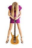 Hot girl playing an electric guitar. Isolated on white background stock photos