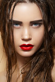 Hot girl with wet hairstyle & fashion make-up. Beautiful young model with long wet hair, red lips makeup, strong eyebrows and perfect purity shiny skin. Fresh stock photos