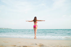 Hot girl wearing pink bikini on the summer beach Royalty Free Stock Images