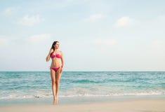 Hot girl wearing pink bikini on the summer beach Royalty Free Stock Photos