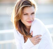 Hot Girls Wearing Sweaters. Hilarious brunette smiling girl wearing white sweater Stock Photo