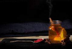 Hot glass of drink tea with orange and pepper Royalty Free Stock Images