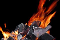 Hot Glowing Charcoal With Bright Flames In The Dark Close-up Royalty Free Stock Images