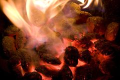 Hot glowing coals. White hot glowing coals with flames stock photos