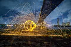 Hot Golden Sparks Flying from Man Spinning Burning Steel Wool un Royalty Free Stock Images