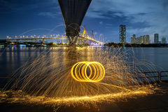 Hot Golden Sparks Flying from Man Spinning Burning Steel Wool un Royalty Free Stock Photos