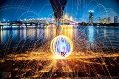 Hot Golden Sparks Flying from Man Spinning Burning Steel Wool un Stock Photography