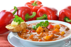Hot goulash soup. Typical Hungarian goulash soup with baguette Royalty Free Stock Photography
