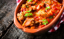 Hot goulash. Traditional Hungarian beef goulash in the stew.Selective focus on thr front meat in stew Stock Image