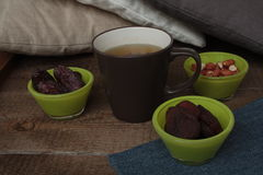 Hot green tea with dried fruit: dried apricots, dates, peanuts. Royalty Free Stock Photos