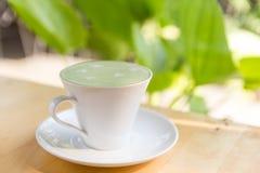 Hot green tea latte Stock Photography