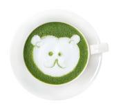 Hot green tea matcha latte cup with cute polar bear face milk fo Stock Photo