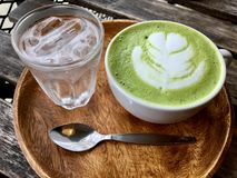 Hot green tea in white cup. Hot green tea in white cup royalty free stock photo