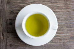 Hot green tea on wood table. Royalty Free Stock Photos