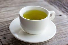 Hot green tea on wood table. Royalty Free Stock Photos