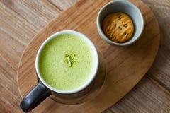 Hot Greentea matcha latte wood background Stock Images