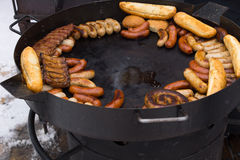 Hot griddle with assorted grilled sausages Stock Photography