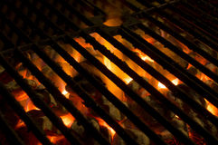 Hot grill. Hot coals burn under grill plate stock photography