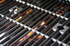 Hot Grill and Fire. A hot grill getting fired up for barbecue Royalty Free Stock Image