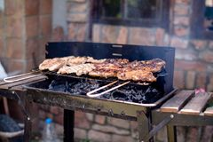 A hot grill full of barbecued meats Royalty Free Stock Images
