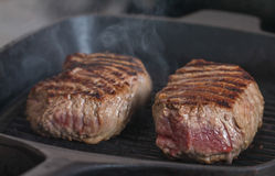 Hot Grilled beef steaks Royalty Free Stock Photos