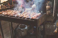Hot food at the festival of street fast food, sausages, hot dog, fried meat. Hot grilled food at the festival of street fast food, sausages, hot dog, fried meat Stock Photography