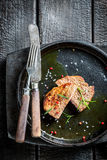 Hot grilled meat with fresh herbs ready to eat. Closeup of Hot grilled meat with fresh herbs ready to eat Stock Images