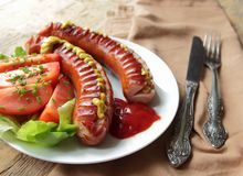 Hot grilled sausages with vegetables Stock Photos