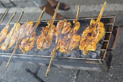 Hot Grilling chickens plugged with bamboo. smoked grill chicken barbecue, thai local food, traditional food Thailand Stock Photos