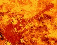 Hot Guitar Background. A faded electric guitar set on a red burning background Stock Photos