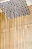 Hot head of a rain shower. Water pours down from a quadratic hot head of a rain shower royalty free stock images