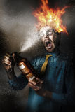 Hot headed nerd businessman playing with fire Stock Image