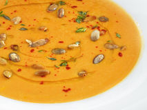 Hot healthy vegetarian pampkin cream soup with pampkin seeds in Royalty Free Stock Images