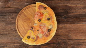 Hot Homemade Pepperoni Pizza Ready to Eat. Pizza pieces disappear from the frame stock footage