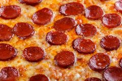 Hot Homemade Pepperoni, salami, cheese Pizza. ready to eat. royalty free stock image