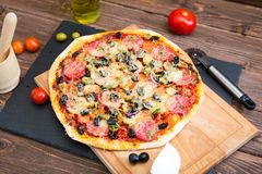 Hot homemade pepperoni on wooden table pizza ready to eat Royalty Free Stock Images