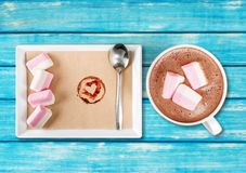Hot. Marshmallows cups closeup cappucino warm table royalty free stock photo