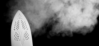 Hot iron. Blowing out steam Royalty Free Stock Images