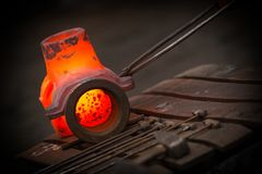 Hot iron in smeltery Stock Images
