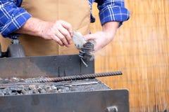 Hot iron working handwork. Wax Royalty Free Stock Image