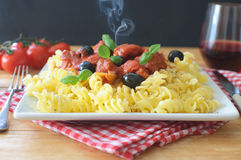 Hot Italian pasta. With chicken savory tomato sauce Royalty Free Stock Photos