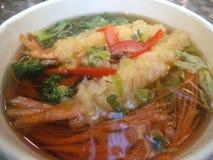 Japanese tempura udon noodle soup. Hot Japanese deep-fried tempura shrimps and udon noodle soup royalty free stock image