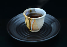 Hot japanese tea serve on tea break. Only in  handmade cup and original plate style Stock Photos