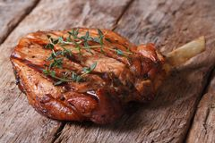 Hot juicy pork steak with thyme on an old table Royalty Free Stock Image