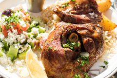 Hot and juicy roasted lamb with greek salad. Authentic Greek food. royalty free stock images