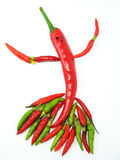 Hot Lady. Fun with chillies. Chillies - big and small - arranged to make a dancing lady figure royalty free stock image