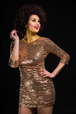 Hot lady in gold Royalty Free Stock Image