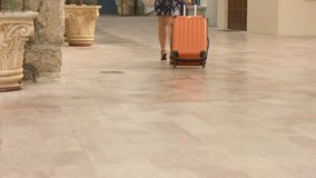 Hot lady rolling comfortable wheel suitcase on vacation, tourist trip abroad. Stock footage stock footage