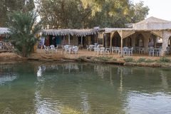 Hot lake. In oasis in Tunisia on Sahara desert . Africa. Camp and hotel resorts in Ksar Ghilan stock image