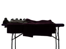 Hot lastones massage therapy silhouette Stock Photo
